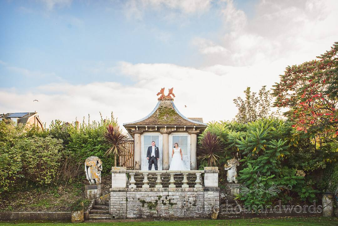Bride and groom at summer house in Purbeck House Hotel Wedding venue gardens