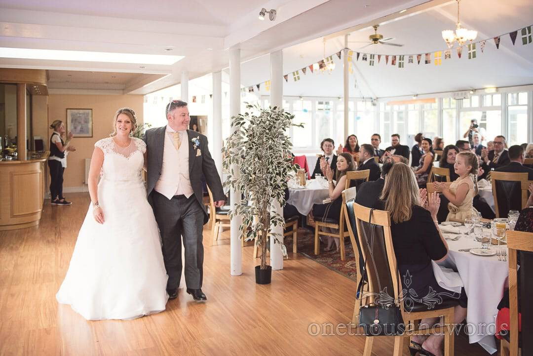 Bride and groom enter wedding breakfast to applause at Purbeck House Hotel