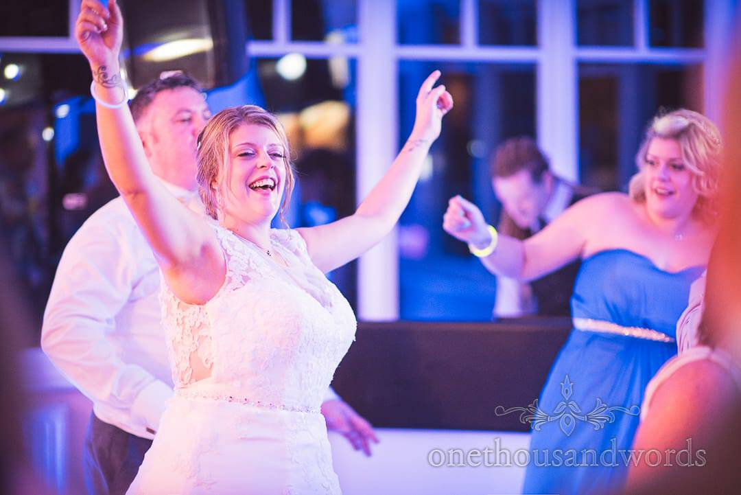 Bride and groom in lights on the dance floor at Swanage Hotel wedding photographs