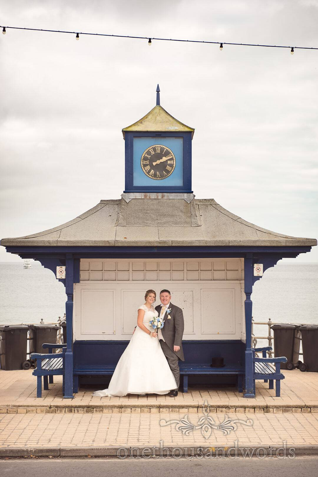 Bride and groom in Swanage Clock Tower by the sea in Dorset
