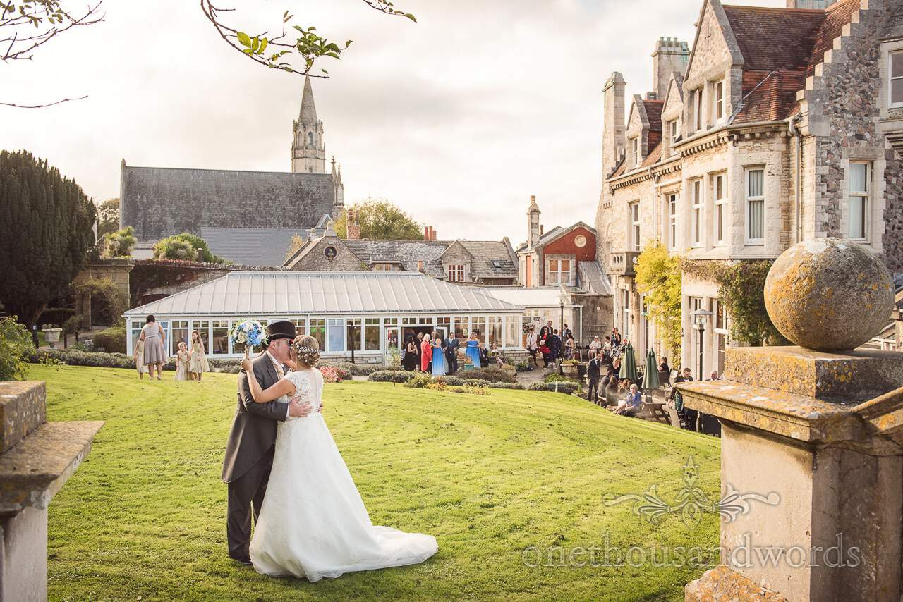 Bride and Groom kiss on the lawns of Purbeck House Hotel Wedding Photographs