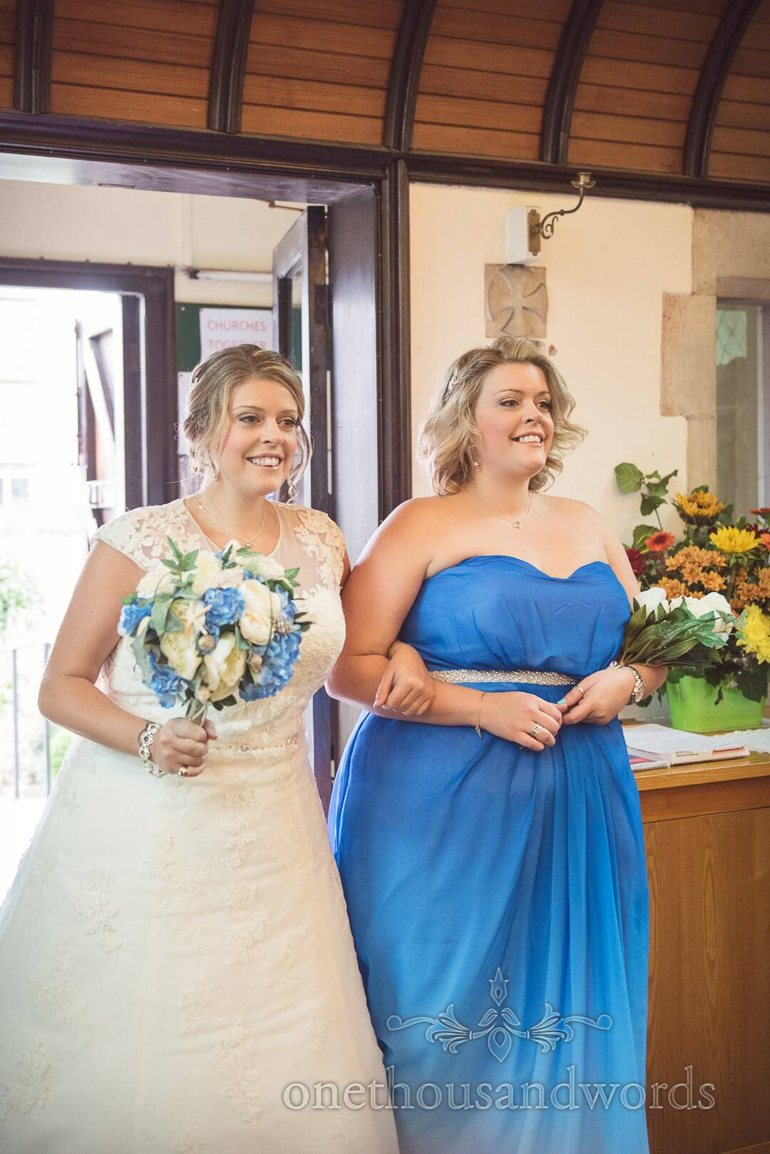 Bride and twin sister enter Catholic church wedding ceremony before walking up aisle