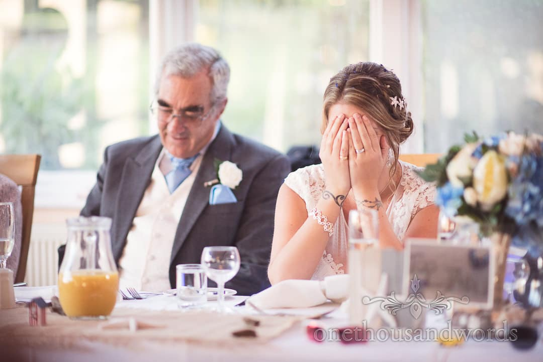 Bride covers her face during wedding speeches at Purbeck House Hotel Wedding