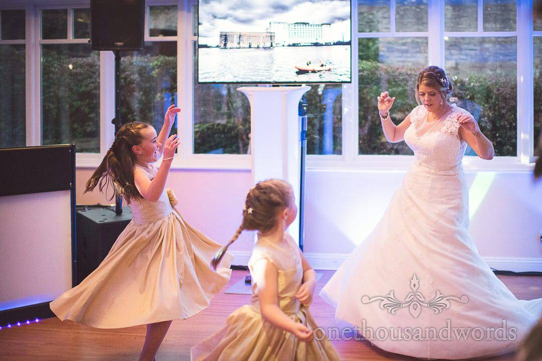 Bride dances with flower girls at Purbeck House Hotel Wedding Photographs