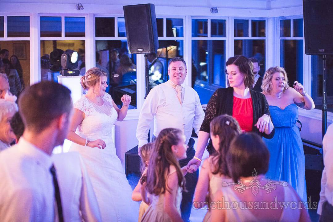 Bride, groom and guests on dance floor at Swanage Hotel wedding photographs