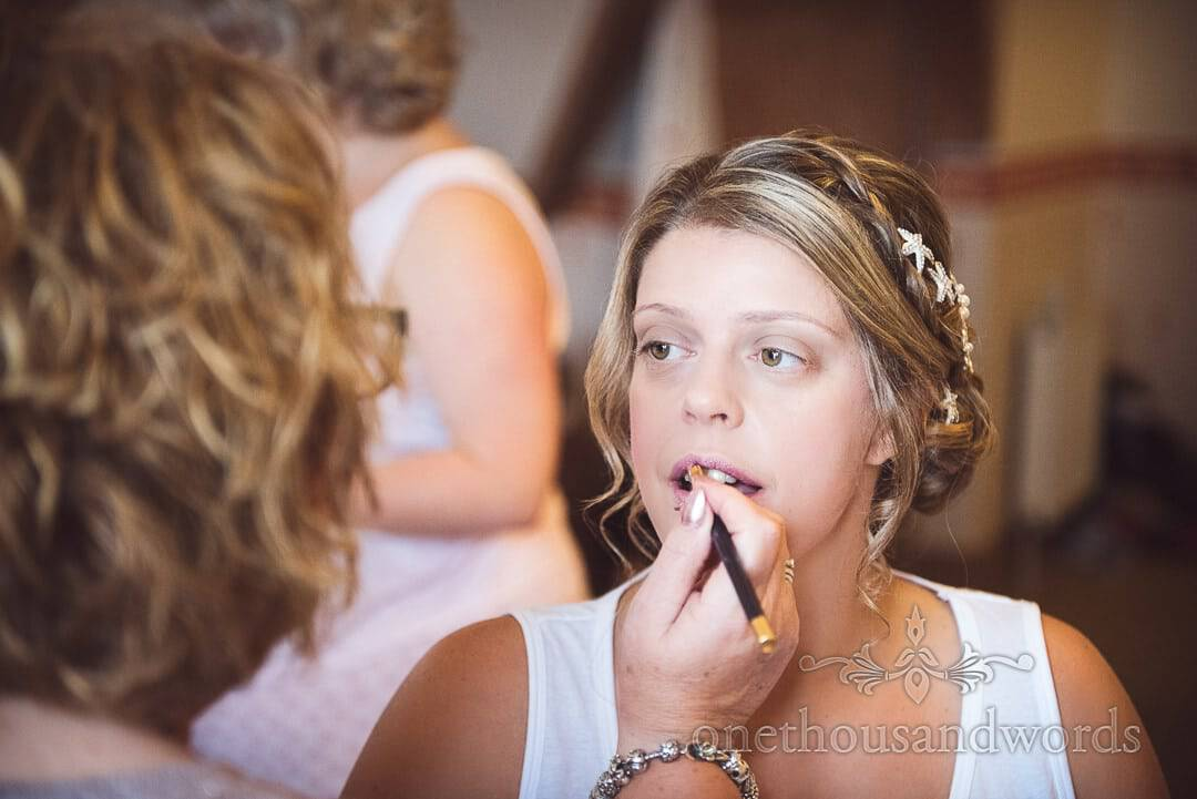 Bride has wedding make up applied during bridal preparations at Purbeck House Hotel