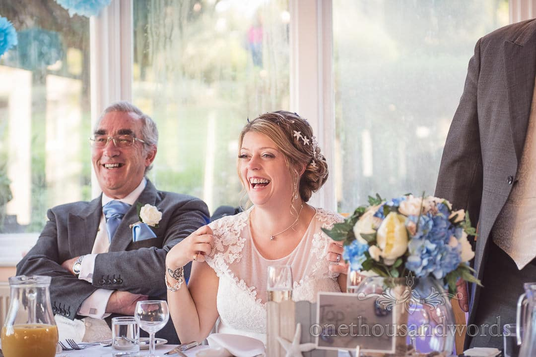 Bride laughing during wedding speeches at Purbeck House Hotel Wedding Photos