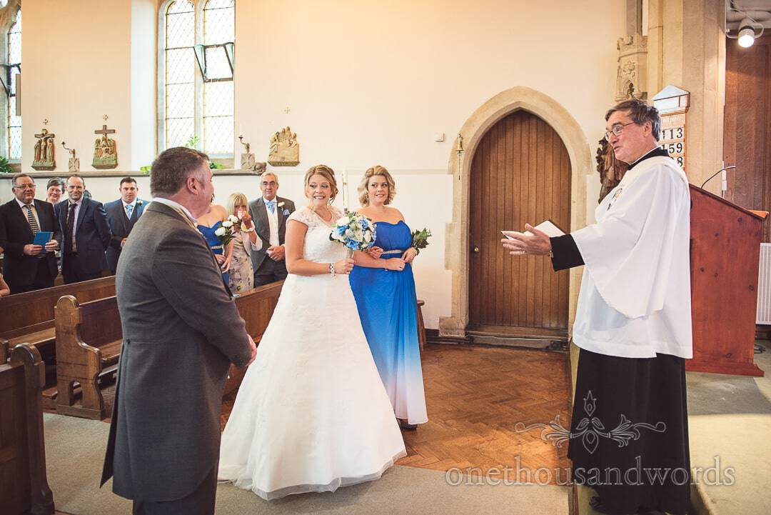 Bride's first look at groom as she arrives at the sacrament in church wedding