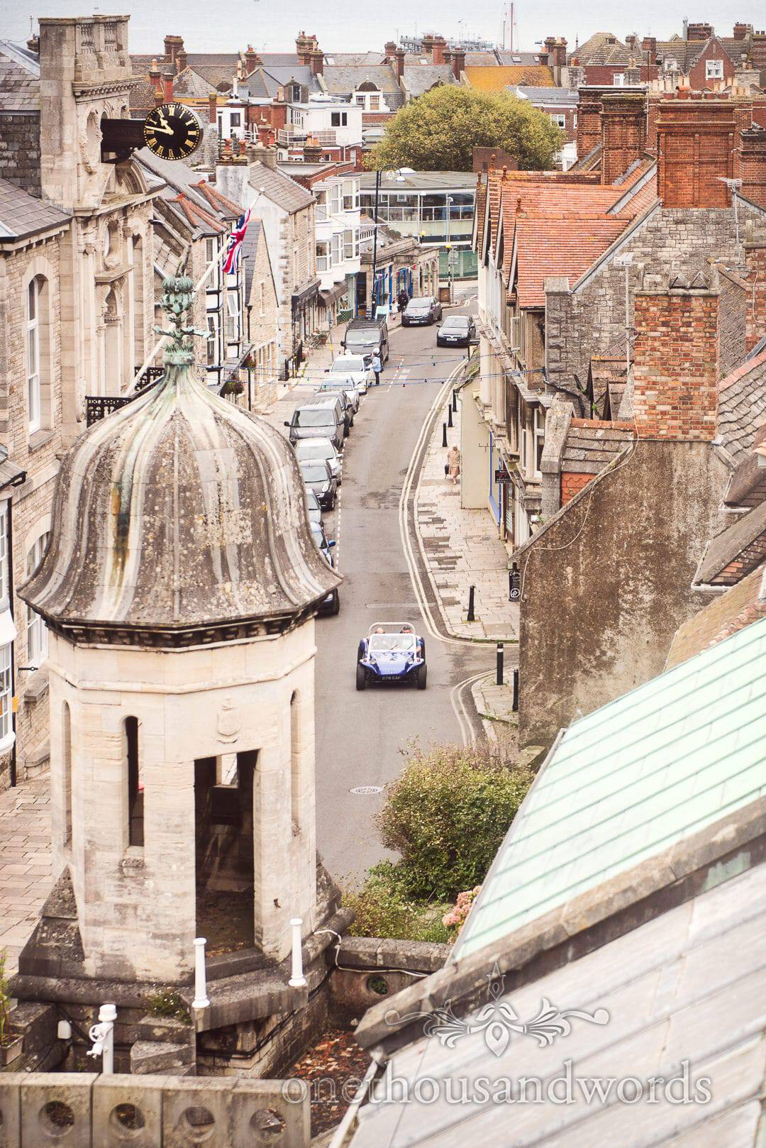 Elevated view of Swanage streets with groom driving VW beach buggy