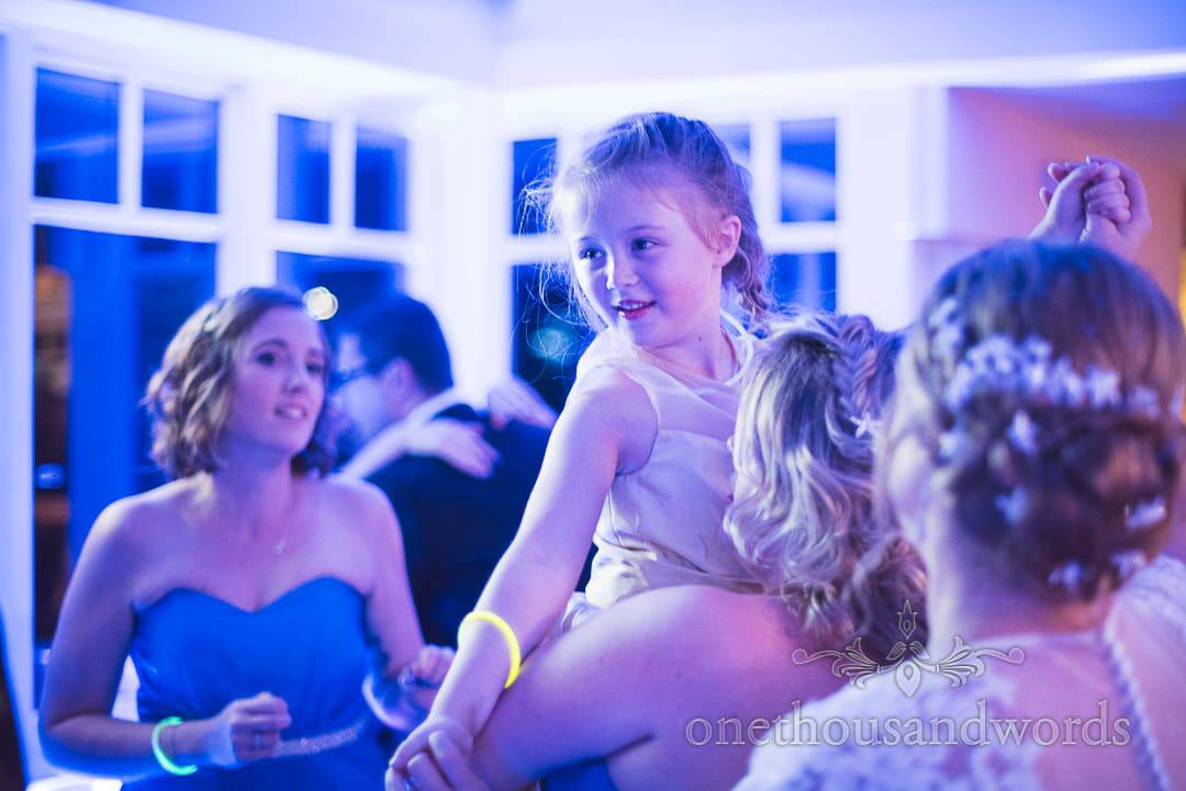 Flower girl and bridesmaids on dance floor at Swanage Hotel wedding photographs