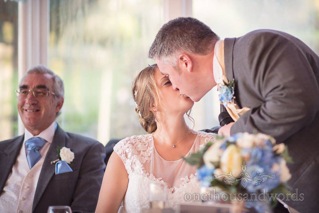 Groom kisses bride during wedding speech at Purbeck House Hotel Wedding