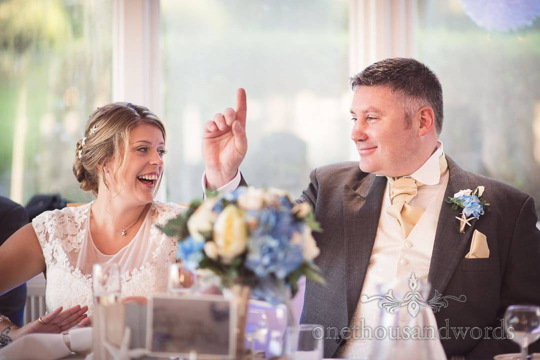 Groom puts finger in air during best man's speech at Purbeck House Hotel Wedding