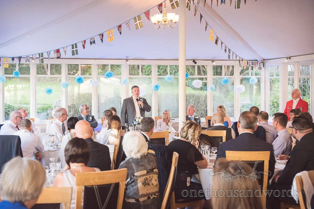 Groom's speech under bunting at Purbeck House Hotel Wedding venue in Swanage