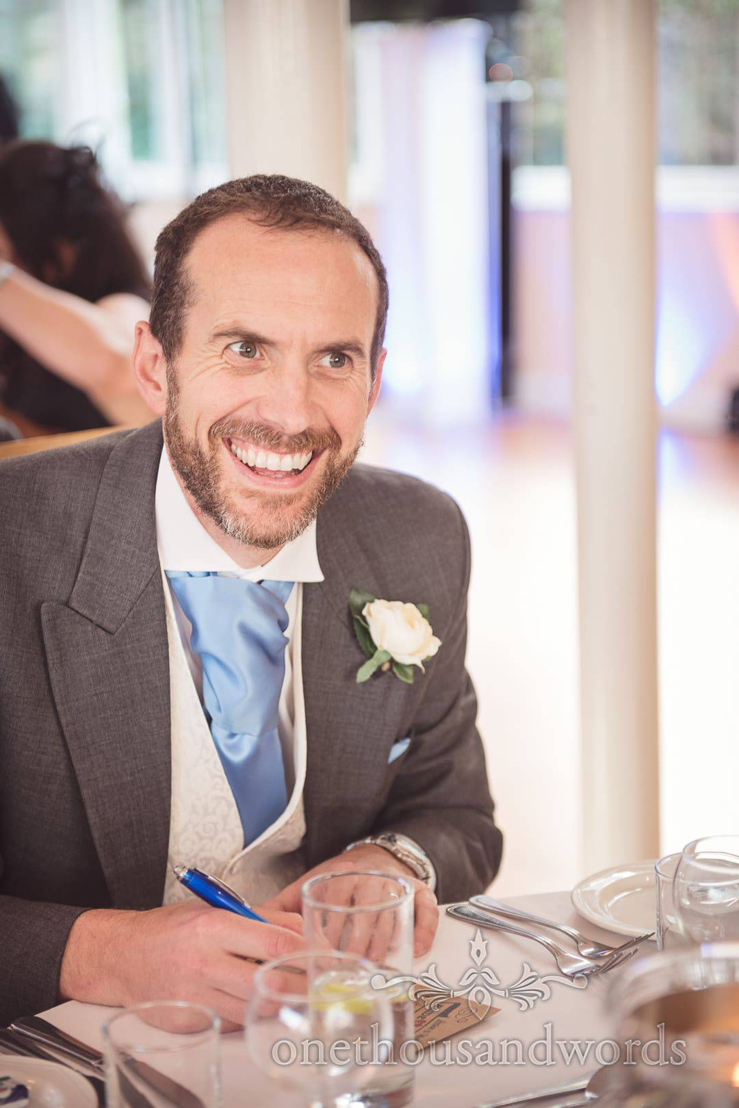 Groomsman writes comments on paper at Purbeck House Hotel Wedding