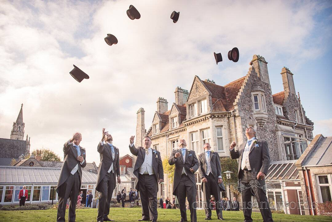Groomsmen throw top hats in air at Purbeck House Hotel Wedding Photographs