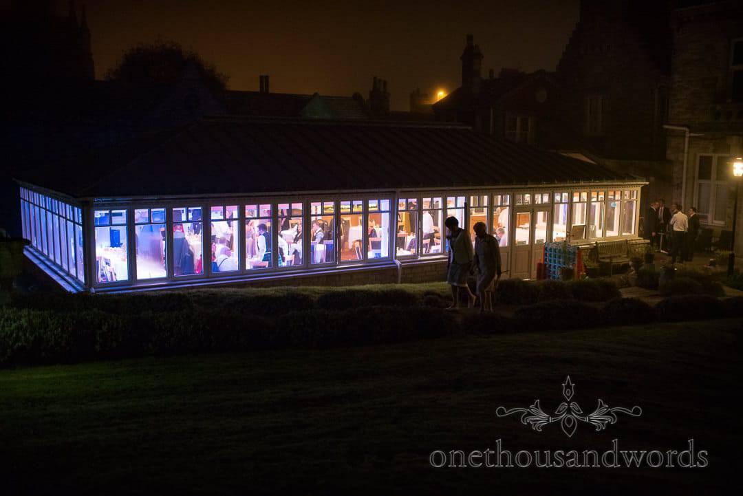 Illuminated garden room reception at Swanage Hotel wedding photographs