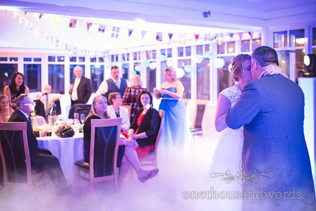 Newlyweds take their first dance at Swanage Hotel wedding photographs