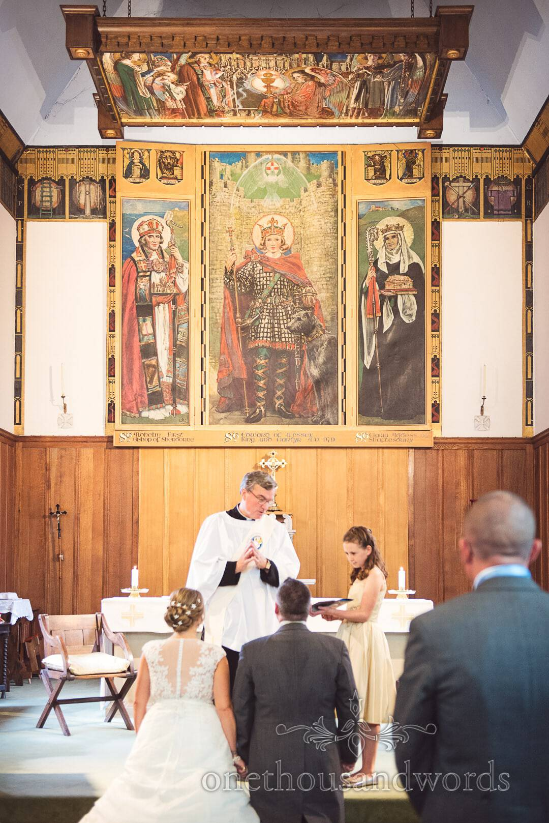 Religious artwork framed with wood and gold at Swanage Catholic Church wedding Ceremony