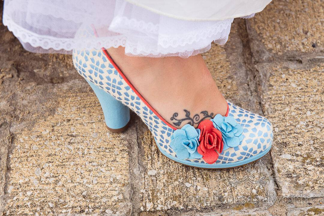 Ruby Shoo Eva Sky Blue wedding shoes with wedding dress and foot tattoo