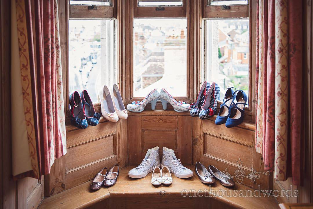 Ruby Shoo wedding shoes with Converse all-star wedding shoes in Hotel window
