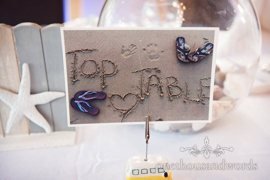 Top Table sign photograph written in sand on beach at Purbeck House Hotel Wedding