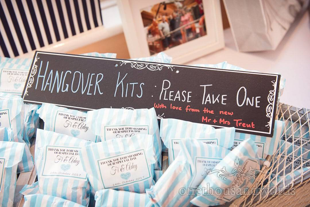 Wedding Hangover Kits sign and personalised blue striped paper bags