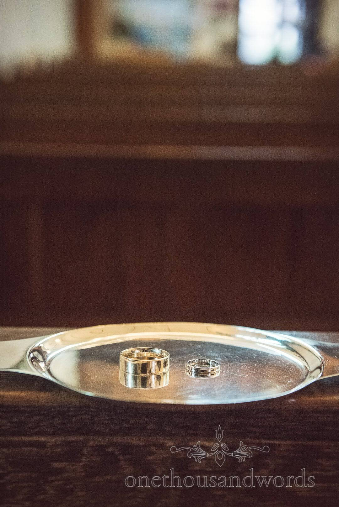 Wedding rings on silver tray in Catholic Church on wedding morning in Swanage