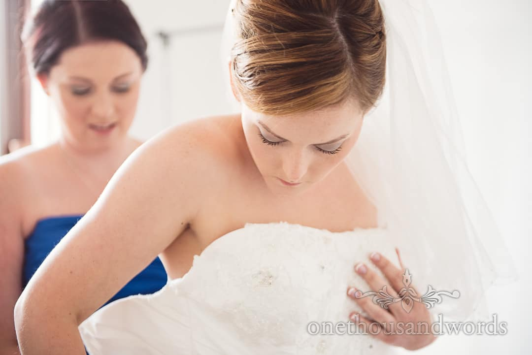 Bride gets into her dress on morning of Upton house wedding