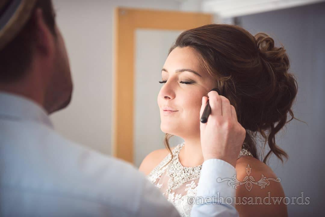 Bride had make up styled on morning of Dorset castle wedding