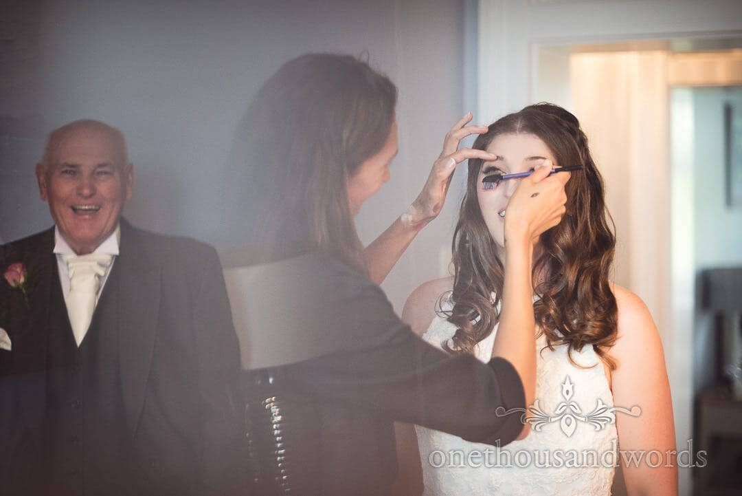 Father of bride reaction as bride has make up styled