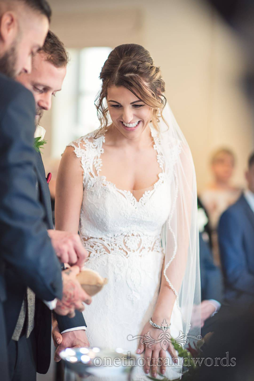 Best mad delivers wedding rings during ceremony at Italian Villa wedding photos