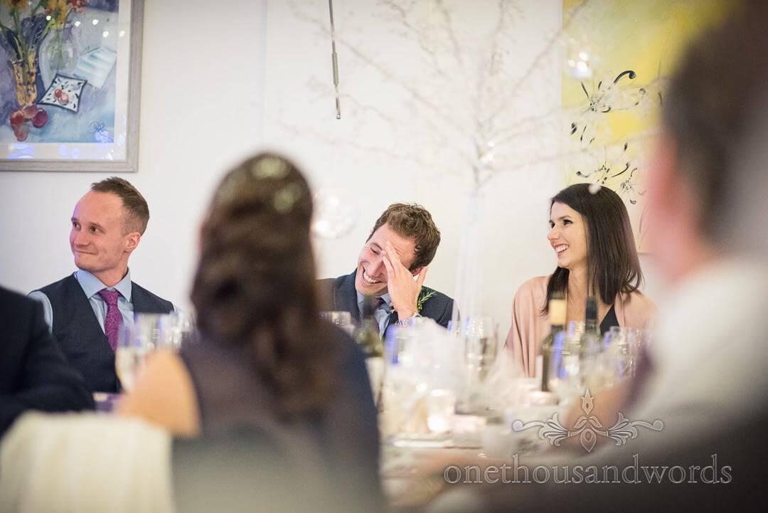 Best men react to grooms speech at The Italian Villa Wedding Venue in Dorset