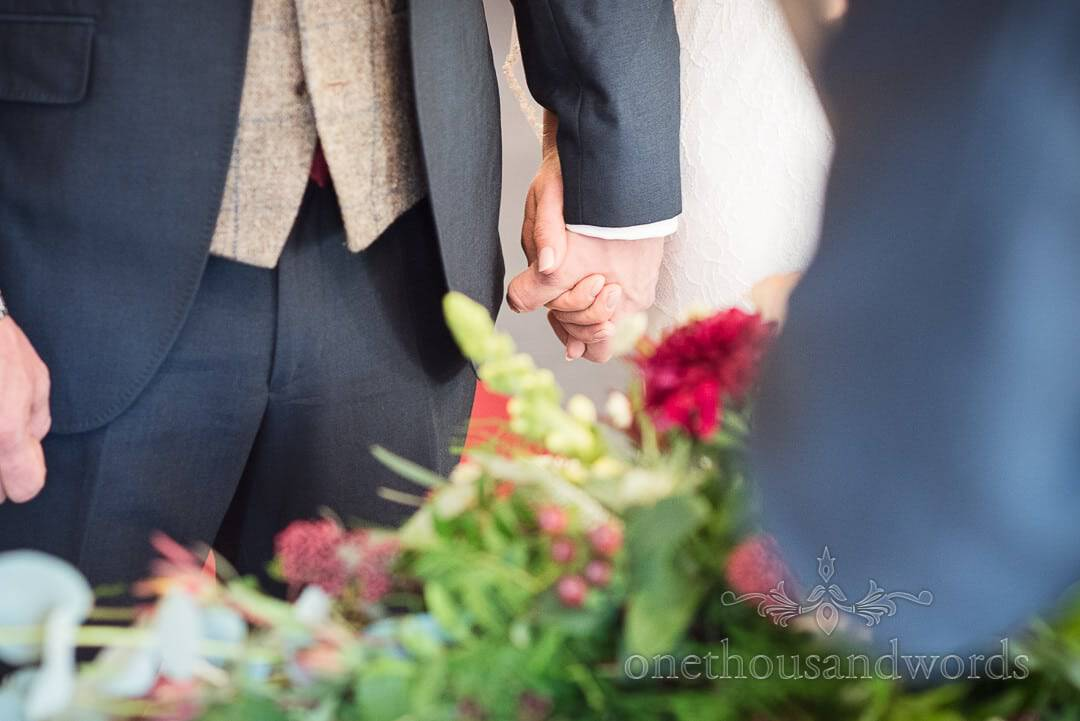 Bride and groom hold hands during civil ceremony at Italian Villa wedding photos