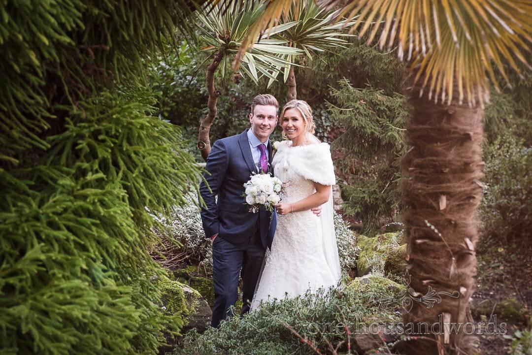 Bride and groom in subtropical gardens at The Italian Villa Wedding Venue in Dorset