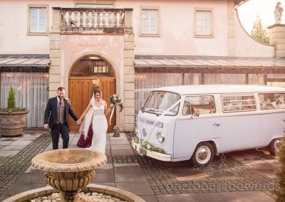 Bride and groom outside Villa with VW wedding bus at Italian Villa wedding photos