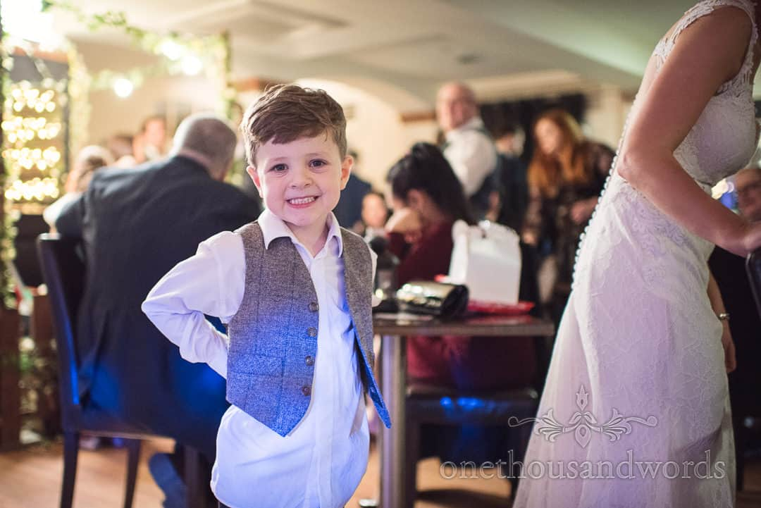 Bride and groom son poses for the camera during reception at Italian Villa wedding photos