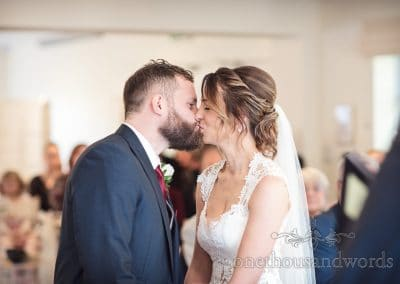 Bride and grooms first kiss from Italian Villa wedding photos