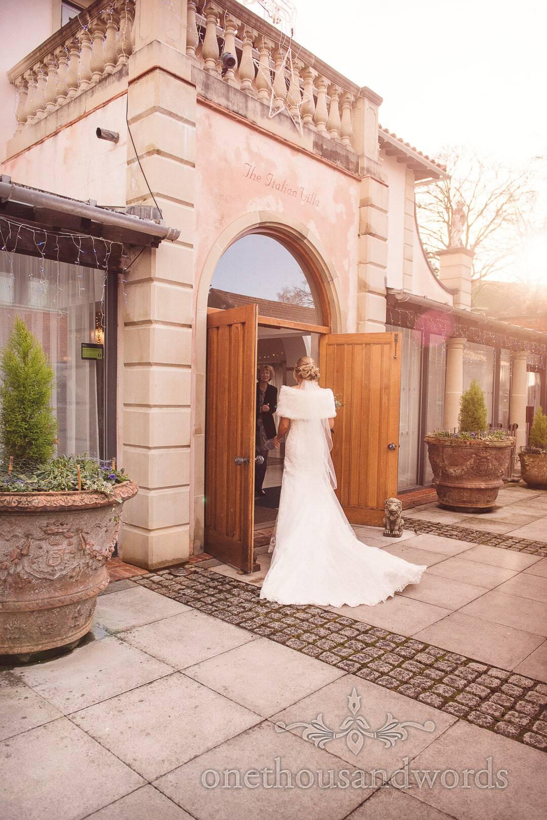 Bride enters Italian Villa Wedding Venue Photographs with Christmas decorations