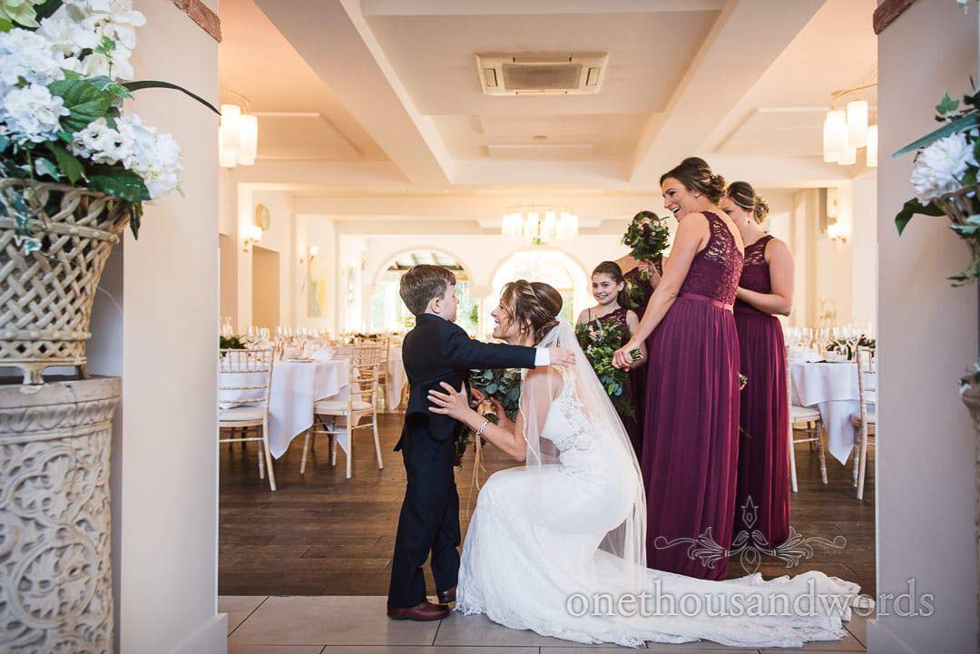 Bride is greeted by son before ceremony at Italian Villa wedding photos