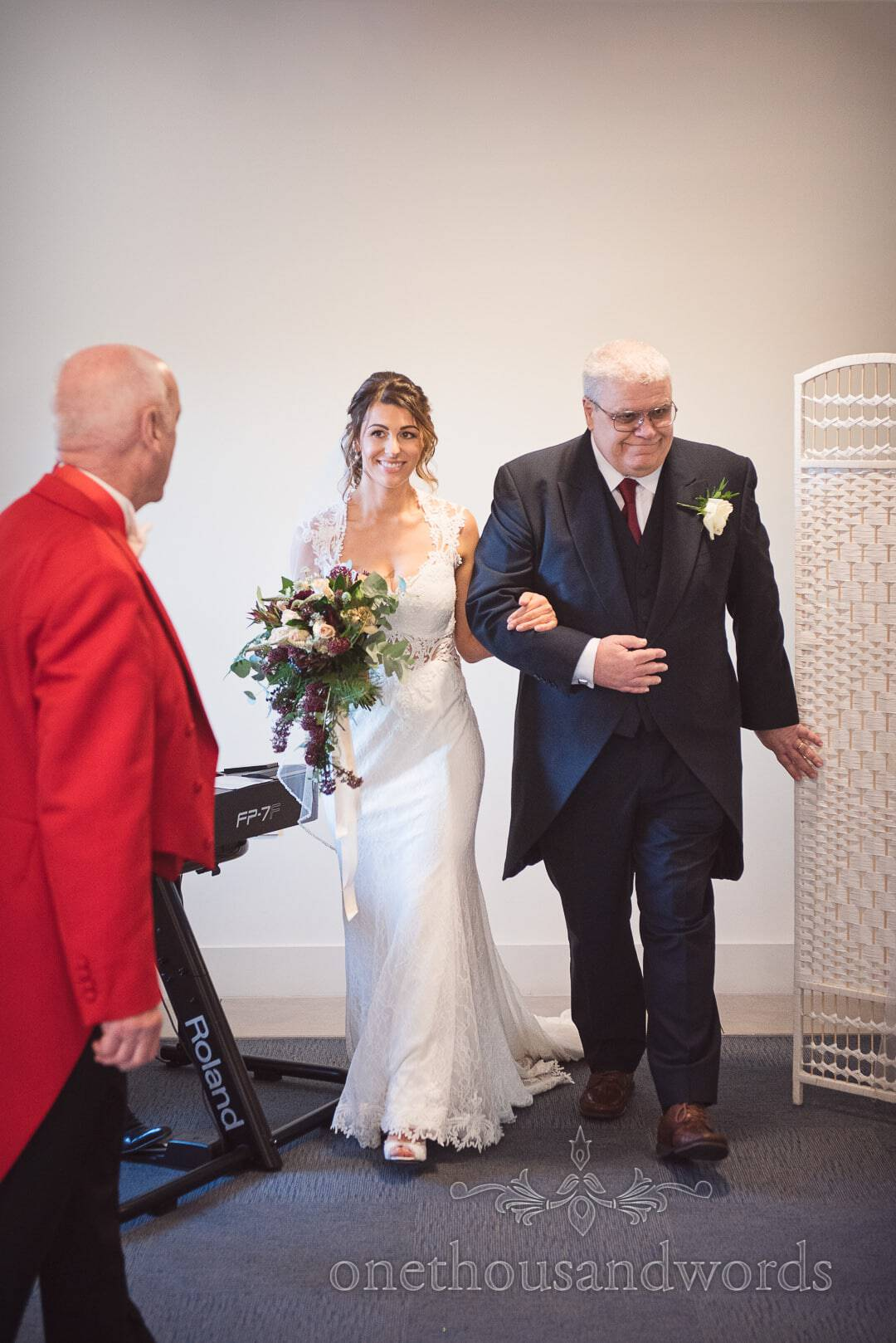 Bride is guided into Italian Villa Wedding by Toastmaster with father on her arm