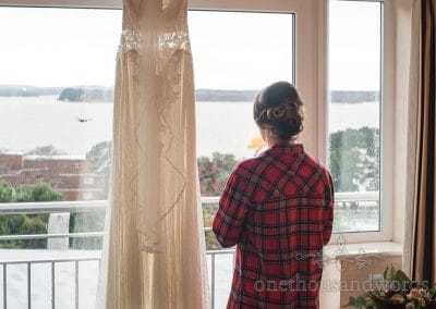 Bride looks out over Poole harbour on morning of Italian Villa wedding