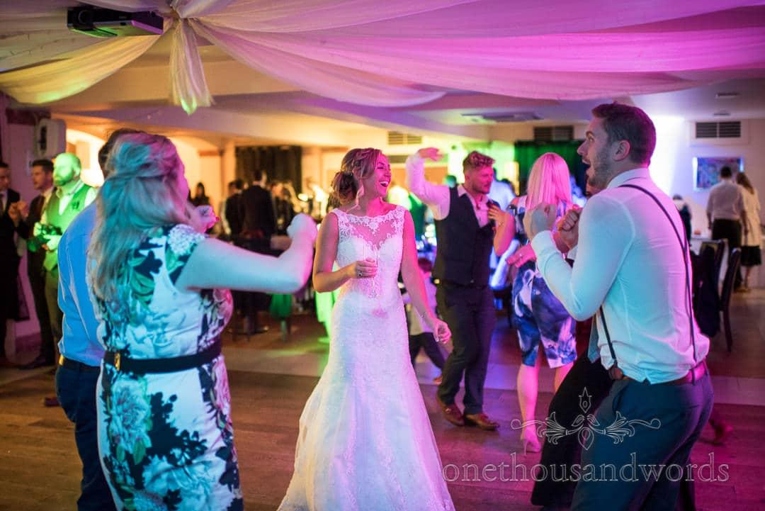 Bride on the dance floor at Italian Villa Wedding venue in Poole Dorset