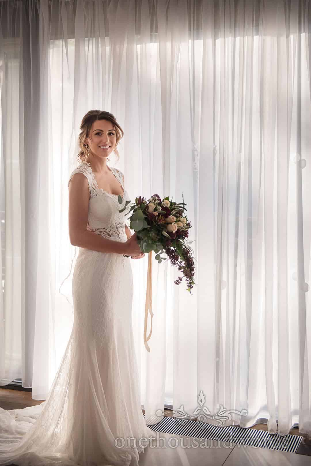 Bride with bouquet before heading to ceremony at Italian Villa wedding photos