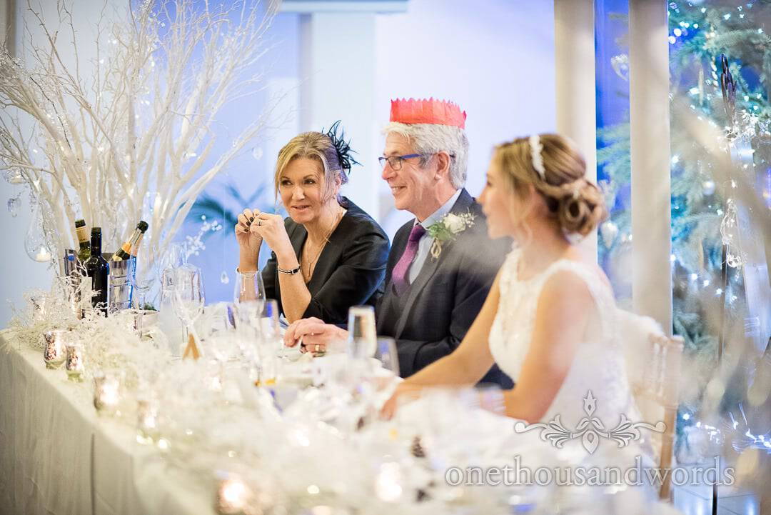 Brides parents on Italian Villa top table surrounded by winter wonderland decorations