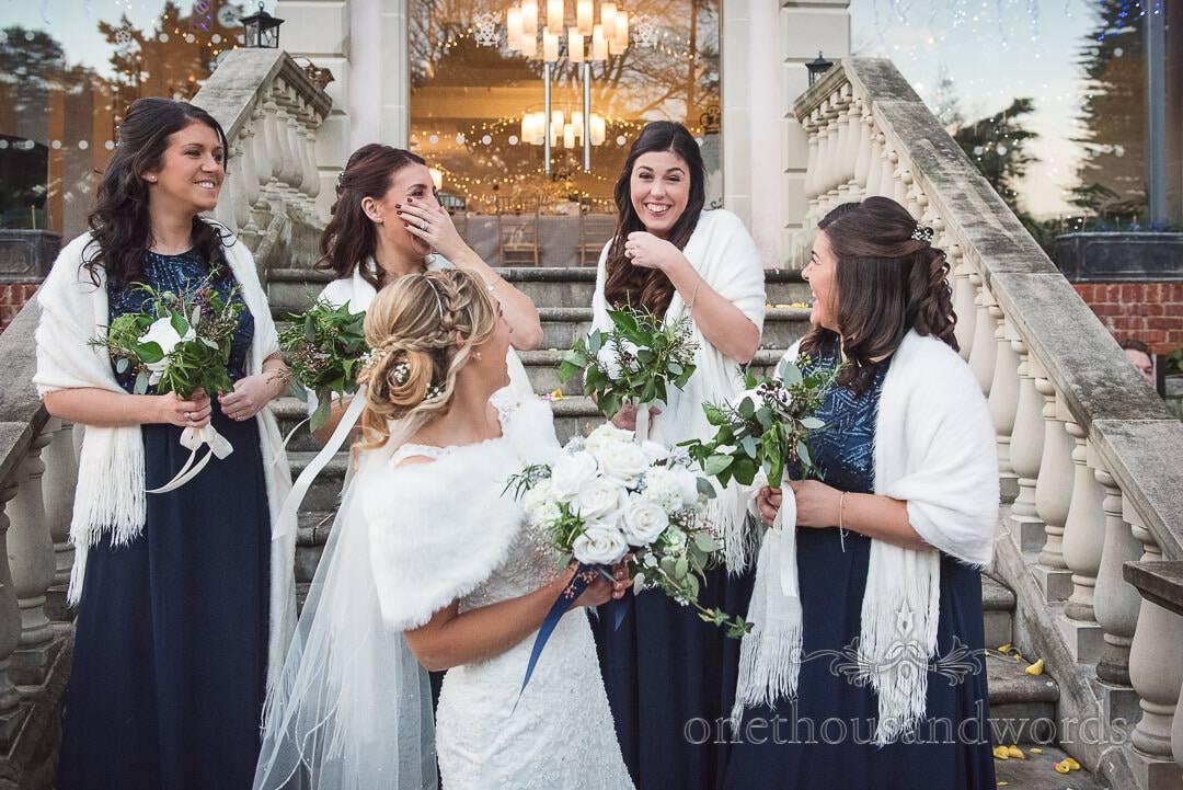 Bridesmaids and bride laughing outside Italian Villa Wedding venue photographs
