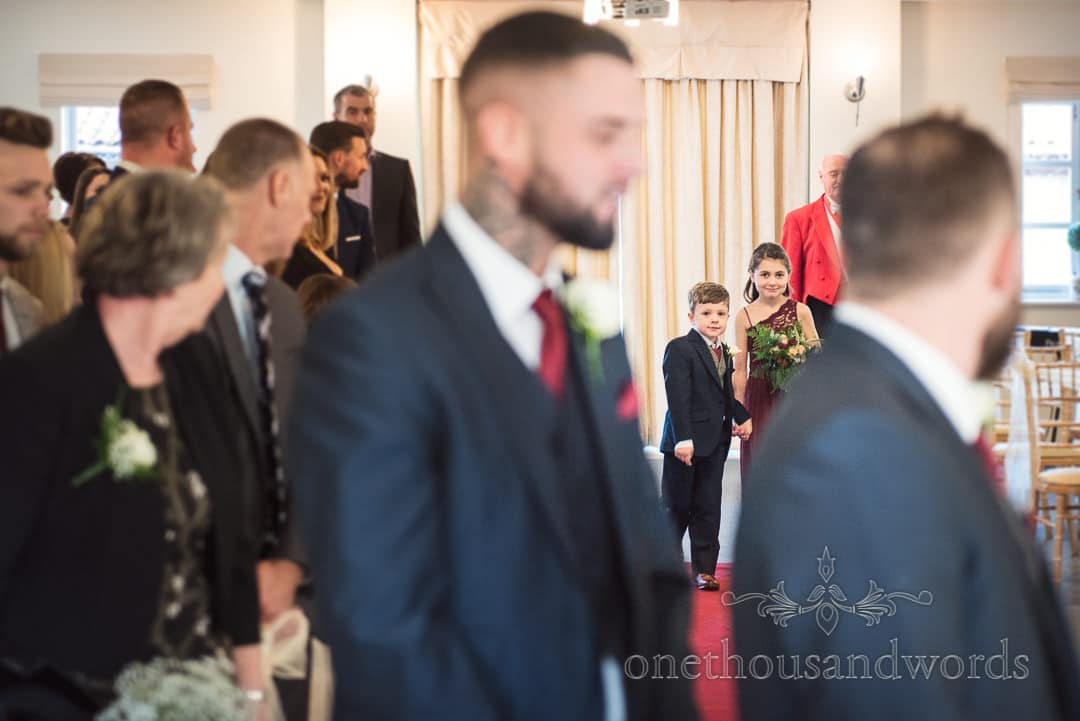 Children lead the bridal party to the ceremony at Italian Villa wedding photos