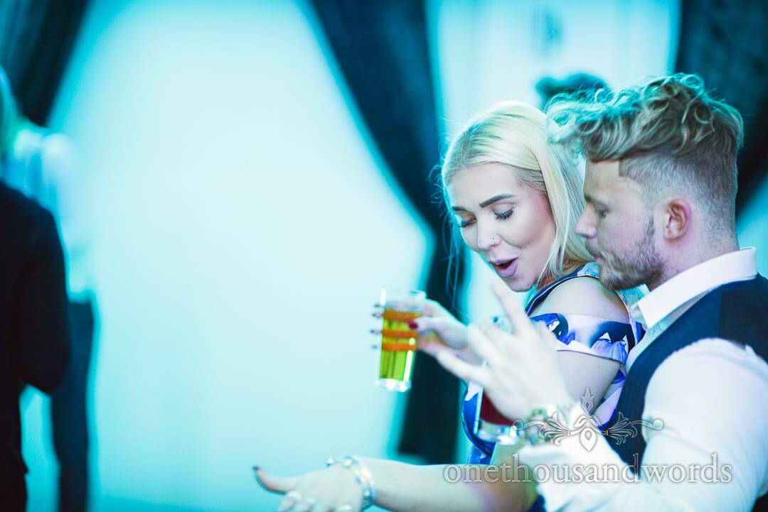 Couple dance together under blue disco lighting at Italian Villa wedding evening
