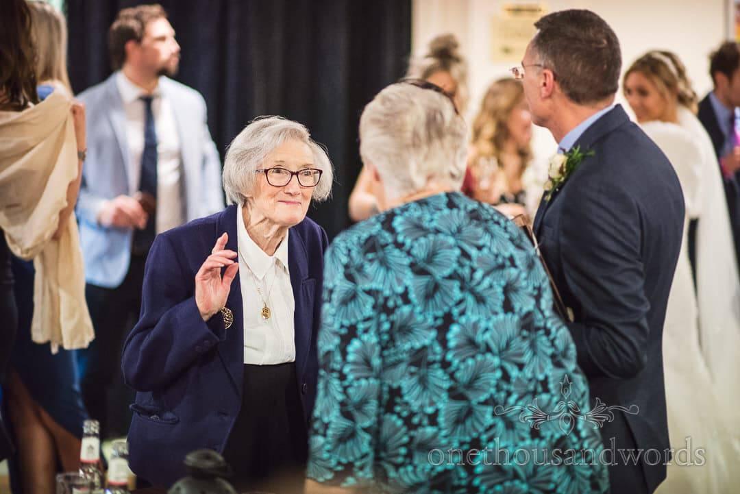 Elderly wedding guest holds happy conversation at The Italian Villa wedding venue