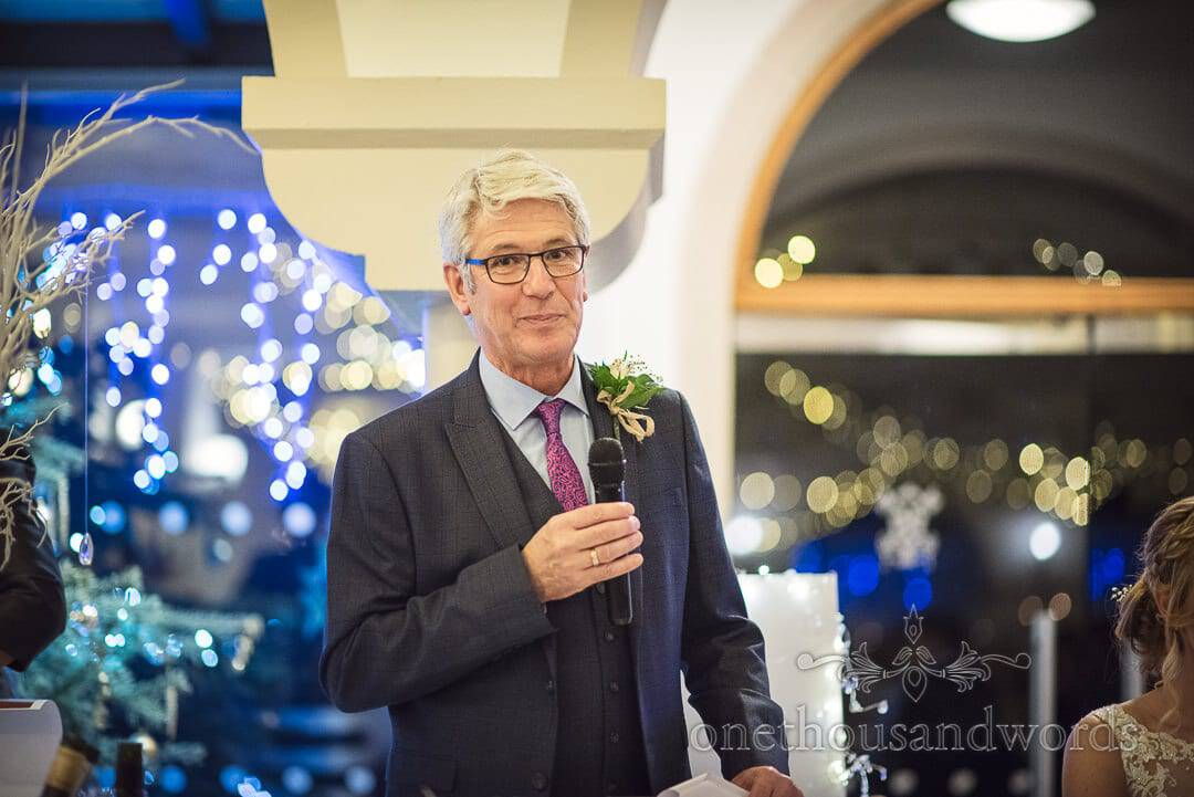 Father of the bride gives wedding speech at The Italian Villa with blue and white fairy lights