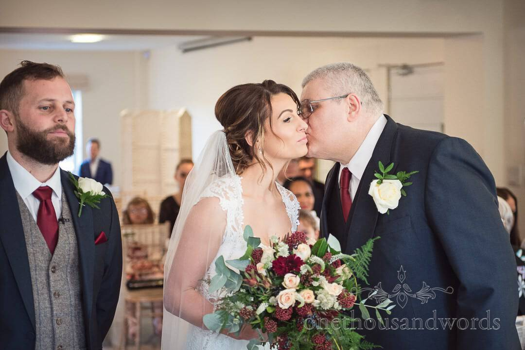 Father of the bride kisses daughter during wedding ceremony at Italian Villa wedding photos